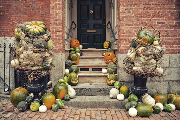 Pumpkins on the steps at the house. Halloween decorations outside